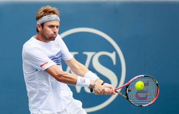 CINCINNATI - AUGUST 22:  Mardy Fish returns a backhand to Roger Federer of Switzerland during the finals on Day 7 of the Western & Southern Financial Group Masters at the Lindner Family Tennis Center on August 22, 2010 in Cincinnati, Ohio.  (Photo by Kevi
