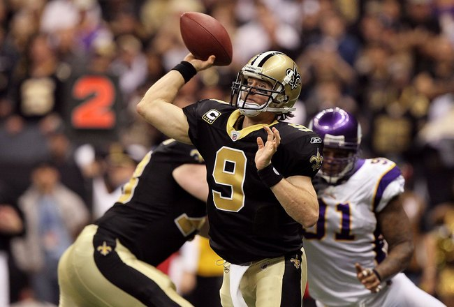 NEW ORLEANS - JANUARY 24:  Drew Brees #9 of the New Orleans Saints throws a pass against the Minnesota Vikings during the NFC Championship Game at the Louisiana Superdome on January 24, 2010 in New Orleans, Louisiana. The Saints won 31-28 in overtime. (Ph