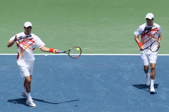 LOS ANGELES, CA - AUGUST 01:  Bob Bryan (L) and brother Mike Bryan follow through on a shot to the team of Eric Butorac and Jean-Julien Rojer during the doubles final of the Farmers Classic at the Los Angeles Tennis Center - UCLA on August 1, 2010 in Los