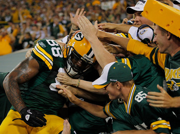 GREEN BAY, WI - AUGUST 26: Jermichael Finley #88 of the Green Bay Packers does a 'Lambeau Leap' into the stands after scoring a touchdown against the Indianapolis Colts during a preseason game at Lambeau Field on August 26, 2010 in Green Bay, Wisconsin. (