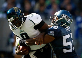 SEATTLE, WA - OCTOBER 11:  Quarterback David Garrard #9 of the Jacksonville Jaguars ids sacked by Darryl Tapp #55 of the Seattle Seahawks   at Qwest Field on October 11, 2009 in Seattle, Washington.  (Photo by Jonathan Ferrey/Getty Images)