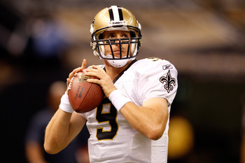 NEW ORLEANS - AUGUST 21:  Drew Brees #9 of the New Orleans Saints warms up during pregame before playing  the Houston Texans at the Louisiana Superdome on August 21, 2010 in New Orleans, Louisiana.  (Photo by Chris Graythen/Getty Images)