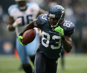 SEATTLE - JANUARY 03:  Wide receiver Deion Branch #83 of the Seattle Seahawks rushes against the Tennessee Titans on January 3, 2010 at Qwest Field in Seattle, Washington. The Titans defeated the Seahawks 17-13. (Photo by Otto Greule Jr/Getty Images)
