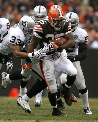CLEVELAND - DECEMBER 27:  Jerome Harrison #35 of the Cleveland Browns runs by Tyvon Branch #33 of the Oakland Raiders at Cleveland Browns Stadium on December 27, 2009 in Cleveland, Ohio.  (Photo by Matt Sullivan/Getty Images)