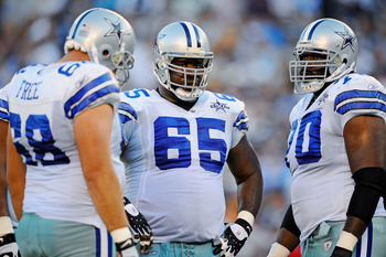 SAN DIEGO - AUGUST 21:  Doug Free #68, Andre Gurode #65 and Leonard Davis #70 of the Dallas Cowboys in action during the pre-season NFL football game against San Diego Chargers at Qualcomm Stadium on August 21, 2010 in San Diego, California.  (Photo by Ke