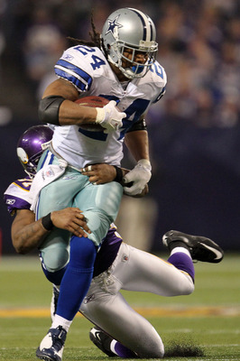 MINNEAPOLIS - JANUARY 17:  Defensive end Ray Edwards #91 of the Minnesota Vikings tackles Marion Barber #24 of the Dallas Cowboys during the third quarter of the NFC Divisional Playoff Game at Hubert H. Humphrey Metrodome on January 17, 2010 in Minneapoli