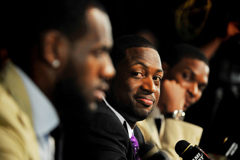 MIAMI - JULY 09:  Dwyane Wade #3 (C) of the Miami Heat talks during a press conference after a welcome party at American Airlines Arena on July 9, 2010 in Miami, Florida.  (Photo by Doug Benc/Getty Images)