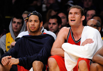 LOS ANGELES, CA - NOVEMBER 29:  Devin Harris (L) Brook Lopez (C) of the New Jersey Nets reacts after a missed shot by a teammate in the closing minutes of the basketball game against the Los Angeles Lakers at Staples Center on November 29, 2009 in Los Ang