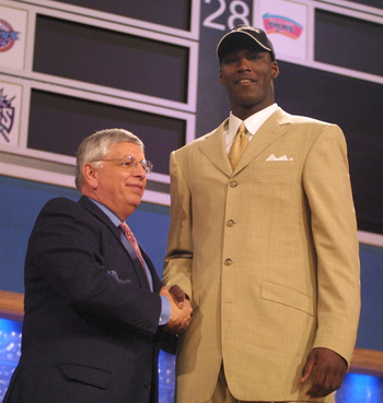 27 Jun 2001:  NBA Commisioner David Stern congratulates Kwame Brown of Glynn Acadamy in Georgia, after being the first pick in the NBA Draft by the Washington Wizards at the Theatre in Madison Square Garden, New York City. Mandatory Credit: Al Bello/ALLSP