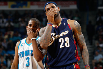 NEW ORLEANS - MARCH 24:  LeBron James #23 of the Cleveland Cavaliers talks with Chris Paul #3 of the New Orleans Hornets at the New Orleans Arena on March 24, 2010 in New Orleans, Louisiana.  The Cavaliers defeated the Hornets 105-92.  NOTE TO USER: User