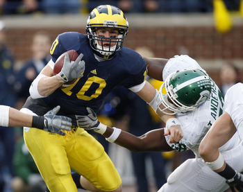ANN ARBOR, MI - OCTOBER 25: Steven Threet #10 of the Michigan Wolverines tries to get around the tackle of Todd Anderson #58 of the Michigan State Spartans during a third quarter sack on October 25, 2008 at Michigan Stadium in Ann Arbor, Michigan. Michiga
