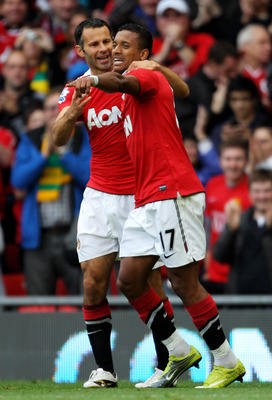 MANCHESTER, ENGLAND - AUGUST 28:  Nani of Manchester United is congratulated by team mate Ryan Giggs (L) after scoring his team's second goal during the Barclays Premier League match between Manchester United and West Ham United at Old Trafford on August