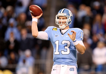 CHARLOTTE, NC - DECEMBER 26:  T.J. Yates #13 of the North Carolina Tar Heels throws a pass against the Pittsburgh Panthers during their game on December 26, 2009 in Charlotte, North Carolina.  (Photo by Streeter Lecka/Getty Images)