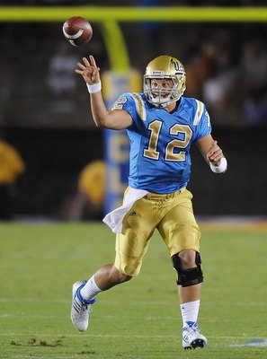 PASADENA, CA - SEPTEMBER 05:   Richard Brehaut #12 of the UCLA Bruins throws the ball against the San Diego State Aztecs at The Rose Bowl on September 5, 2009 in Pasadena, California.  (Photo by Lisa Blumenfeld/Getty Images)