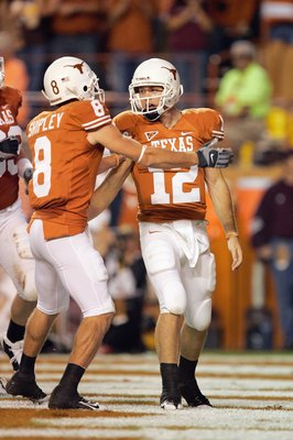 AUSTIN, TX - NOVEMBER 27:  Quarterback Colt McCoy #12 of the Texas Longhorns is congratulated by Jordan Shipley #8 during the game against the Texas A&M Aggies on November 27, 2008 at Darrell K Royal-Texas Memorial Stadium in Austin, Texas.  Texas won 49-