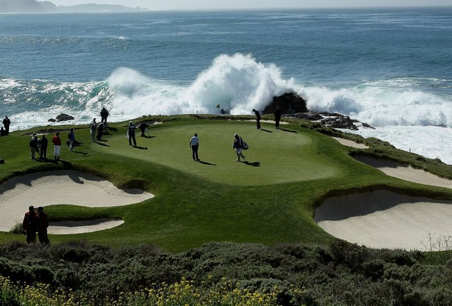 PEBBLE BEACH, CA - FEBRUARY 14:  Surf crashes as a group plays the seventh hole during the final round of the AT&T Pebble Beach National Pro-Am at Pebble Beach Golf Links on February 14, 2010 in Pebble Beach, California.  (Photo by Stephen Dunn/Getty Imag