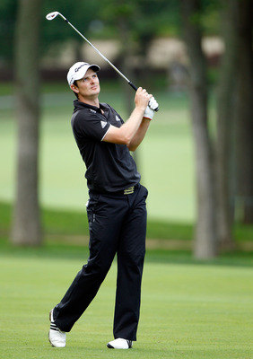 DUBLIN, OH - JUNE 06:  Justin Rose of England hits his approach shot on the 14th hole during the final round of the Memorial Tournament presented by Morgan Stanley at Muirfield Village Golf Club on June 6, 2010 in Dublin, Ohio.  (Photo by Scott Halleran/G