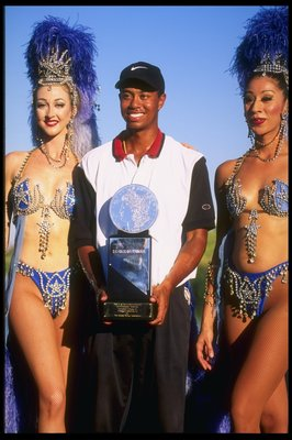 6 Oct 1996:  Tiger Woods holds his trophy while being accompanied by two Las Vegas showgirls after winning the Las Vegas Invitational in Las Vegas, Nevada.   Mandatory Credit: J.D. Cuban/Allsport