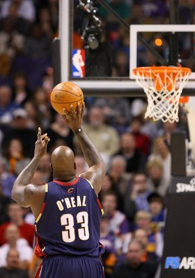PHOENIX - DECEMBER 21:  Shaquille O'Neal #33 of the Cleveland Cavaliers shoots a free throw shot during the NBA game against of the Phoenix Suns at US Airways Center on December 21, 2009 in Phoenix, Arizona. The Cavaliers defeated the Suns 109-91.  NOTE T