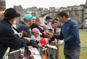 ST ANDREWS, SCOTLAND - JULY 12:  Sir Nick Faldo of England signing autographs during practice for the 139th Open Championship on the Old Course, St Andrews on July 12, 2010 in St Andrews, Scotland.  (Photo by Ross Kinnaird/Getty Images)