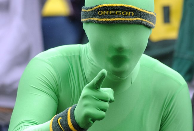 EUGENE, OR - SEPTEMBER 19: Oregon fan 'Greenman' cheers on his team in the first quarter of the game between the Utah Utes and the Oregon Ducks at Autzen Stadium on September 19, 2009 in Eugene, Oregon. Oregon won the game 31-24. (Photo by Steve Dykes/Get