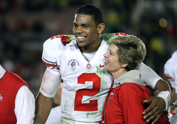 PASADENA, CA - JANUARY 01:  Quarterback Terrelle Pryor #2 of the Ohio State Buckeyes celebrates with Ellen Tressel after the buckeyes 26-17 win in the 96th Rose Bowl game over the Oregon Ducks on January 1, 2010 in Pasadena, California.  (Photo by Stephen