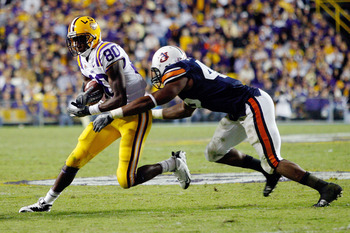 BATON ROUGE, LA - OCTOBER 24:  Terrance Toliver #80 of the Louisiana State University Tigers is tackled by Antoine Carter #45 of the Auburn Tigers at Tiger Stadium on October 24, 2009 in Baton Rouge, Louisiana.  (Photo by Chris Graythen/Getty Images)