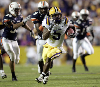 BATON ROUGE, LA - OCTOBER 22:  Skyler Green #5  of Louisiana State University runs past the Auburn University defense to score a 65-yard touchdown on a punt return on October 22, 2005 at Tiger Stadium in Baton Rouge, Louisiana.   (Photo by Chris Graythen/