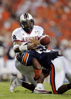 AUBURN, AL - OCTOBER 1:  Redshirt freshman quarterback Antonio Heffner #18 of the South Carolina Gamecocks fumbles the ball for a turnover as he is hit by linebacker Travis Williams #51 of the Auburn Tigers in the first quarter on October 1, 2005 at Jorda
