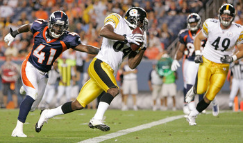 DENVER - AUGUST 29: Wide receiver Antonio Brown #84 of the Pittsburgh Steelers beats cornerback Cassius Vaughn #41 of the Denver Broncos and scores a touchdown at INVESCO Field at Mile High on August 29, 2010 in Denver, Colorado.  (Photo by Justin Edmonds