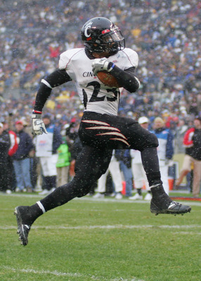 PITTSBURGH - DECEMBER 05:  Isaiah Pead #23 of the Cincinnati Bearcats scores a touchdown in the fourth quarter against the University of Pittsburgh Panthers on December 5, 2009 at Heinz Field in Pittsburgh, Pennsylvania.  (Photo by Jared Wickerham/Getty I