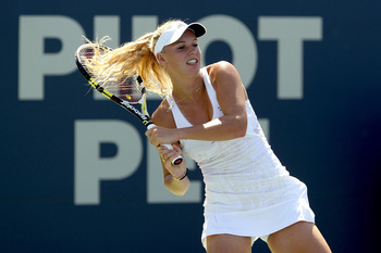 NEW HAVEN, CT - AUGUST 28:  Top seed Caroline Wozniacki of Denmark returns a shot to Nadia Petrova of Russia during the final of the Pilot Pen tennis tournament at the Connecticut Tennis Center on August 28, 2010 in New Haven, Connecticut. Wozniacki beat