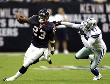 HOUSTON - AUGUST 28:  Running back Arian Foster #23 of the Houston Texans avoids a tackle from cornerback Terrence Newman #41 of the Dallas Cowboys in the first quarter of a preseason game at Reliant Stadium on August 28, 2010 in Houston, Texas.  (Photo b