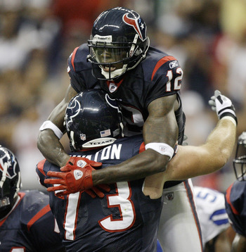 HOUSTON - AUGUST 28:  Wide receiver Jacoby Jones #12 of the Houston Texans celebrates his touchdown reception with Eric Winston #73 in the first quarter against the Dallas Cowboys in a preseason game at Reliant Stadium on August 28, 2010 in Houston, Texas