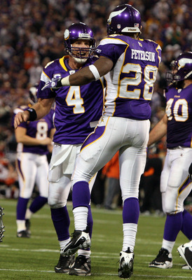 MINNEAPOLIS, MN - DECEMBER 13:  Adrian Peterson #28 of the Minnesota Vikings celebrates his third quarter touchdown against the Cincinnati Bengals with teammate Brett Favre #4 on December 13, 2009 at Hubert H. Humphrey Metrodome in Minneapolis, Minnesota.