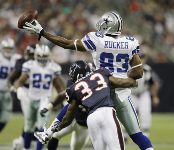 HOUSTON - AUGUST 28: Tight end Martin Rucker #83 of the Dallas Cowboys loses the ball as he his hit by safety Troy Nolan in the third quarter at Reliant Stadium on August 28, 2010 in Houston, Texas. Houston won 23-7. (Photo by Bob Levey/Getty Images)
