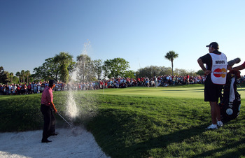 ORLANDO, FL - MARCH 29:  Tiger Woods of the USA plays his second shot from a plugged lie in the bunker at the 14th hole during the final round of the Arnold Palmer Invitational Presented by Mastercard at the Bay Hill Club and Lodge on March 29, 2009 in Or