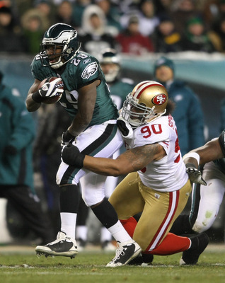 PHILADELPHIA - DECEMBER 20: LeSean McCoy #29 of the Philadelphia Eagles is tackled by Isaac Sopaga #90 of the San Francisco 49ers at Lincoln Financial Field on December 20, 2009 in Philadelphia, Pennsylvania.  (Photo by Nick Laham/Getty Images)