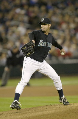 SEATTLE - SEPTEMBER 30:  Starting pitcher Jamie Moyer #50 of the Seattle Mariners winds back to pitch during a game against the Oakland Athletics on September 30 2005 at Safeco Field in Seattle Washington. The Mariners won 4-1. (Photo by Otto Greule Jr/Ge