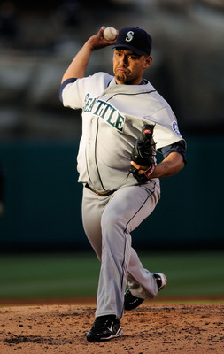 ANAHEIM, CA - APRIL 25: Pitcher Carlos Silva #52 of the Seattle Mariners throws against the Los Angeles Angels during the thrid inning of the baseball game on April 25, 2009 at Angel Stadium in Anaheim, California. (photo by kevork Djansezian/Getty Images