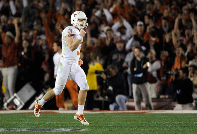 PASADENA, CA - JANUARY 07:  Quarterback Garrett Gilbert #3 of the Texas Longhorns celebrates after wide receiver Jordan Shipley #8 scores a 28-yard touchdown against the Alabama Crimson Tide during the fourth quarter of the Citi BCS National Championship
