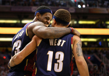 PHOENIX - DECEMBER 21:  LeBron James #23 of the Cleveland Cavaliers celebrates with teammate Delonte West #13 after a three point play against the Phoenix Suns during the NBA game at US Airways Center on December 21, 2009 in Phoenix, Arizona. The Cavalier