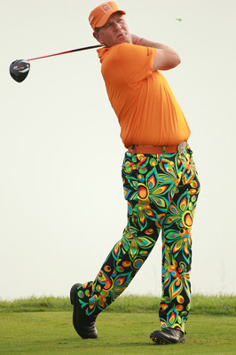 KOHLER, WI - AUGUST 10:  John Daly hits a tee shot during a practice round prior to the start of the 92nd PGA Championship on the Straits Course at Whistling Straits on August 10, 2010 in Kohler, Wisconsin.  (Photo by Andrew Redington/Getty Images)