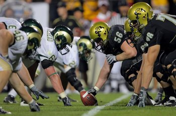 BOULDER, CO - SEPTEMBER 06:  Center Keenan Stevens #56 of the Colorado Buffaloes prepares to snap the ball on the line of scrimmage against the Colorado State Rams at Folsom Field on September 6, 2009 in Boulder, Colorado. The Rams defeated the Buffaloes