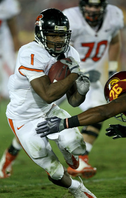LOS ANGELES - OCTOBER 24:   Running back Jacquizz Rodgers #1 of the Oregon State Beavers carries the ball against the USC Trojans on October 24, 2009 at the Los Angeles Coliseum in Los Angeles, California.  USC won 42-36.  (Photo by Stephen Dunn/Getty Ima