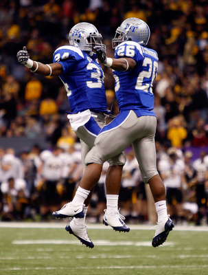 NEW ORLEANS - DECEMBER 20:   Marquise Branton #34 and Stuart Taylor #26 of the Middle Tennessee Blue Raiders celebrate after a touchdown against the Southern Miss Golden Eagles during the R+L Carriers New Orleans Bowl at the Louisiana Superdome on Decembe