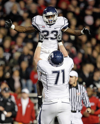 CINCINNATI - NOVEMBER 07:  Jordan Todman #23 of the Connecticut Huskies celebrates with Mike Ryan #71 after running for a touchdownl against the Cincinnati Bearcats during the Big East Conference game at Nippert Stadium on November 7, 2009 in Cincinnati,