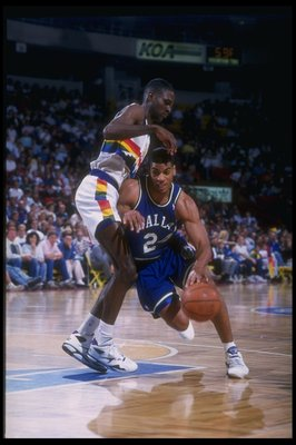 1992-1993:  Guard Jim Jackson of the Dallas Mavericks moves the ball during a game against the Denver Nuggets at McNichols Arena in Denver, Colorado. Mandatory Credit: Tim DeFrisco  /Allsport Mandatory Credit: Tim DeFrisco  /Allsport