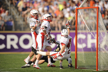BALTIMORE, MD - MAY 29:  AJ Fiore #47 of the Cornell Big Red makes a save against the Notre Dame Fighting Irish during the 2010 NCAA Division 1 Lacrosse Semifinal Championship game on May 29, 2010 at M & T Bank Stadium in Baltimore, Maryland.  (Photo by M