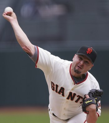 SAN FRANCISCO - APRIL 9:  Jason Schmidt #29 of the San Francisco Giants pitches against the Atlanta Braves at AT&T Park on April 9, 2006 in San Francisco, California. The Giants defeated the Braves 6-5.  (Photo by Jed Jacobsohn/Getty Images)